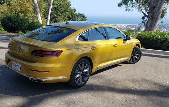The 2019 VW Arteon looks out over the Santa Barbara harbor in Kurkuma Yellow Metallic paint.
