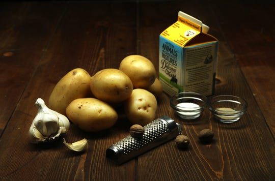 Pommes dauphinoise consists of just six ingredients — cream, garlic, salt, white pepper, nutmeg and the star, potatoes.