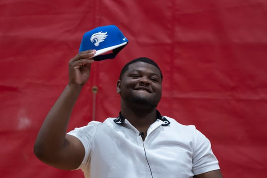 Oak Park guard Justin Rogers reveals a cap to announce his decision to attend Kentucky during an event Monday at Oak Park High School.