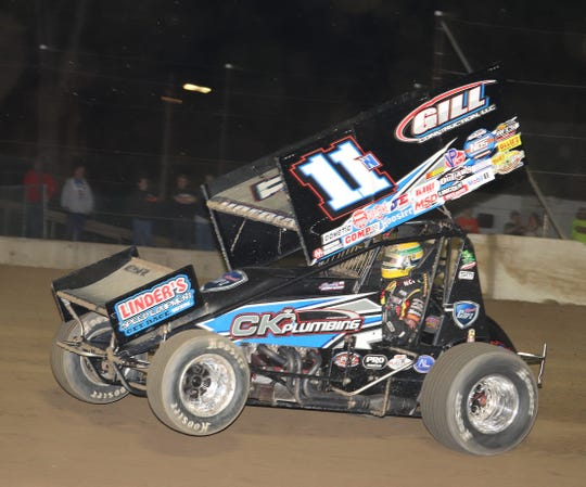 Buddy Kofoid pops a wheelie on his way to victory at Fremont Speedway.