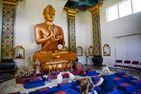 People meditate inside the Great Stupa of Dharmakaya at Shambhala Mountain Center, Wednesday, July 29, 2015, in Red Feather Lakes, CO.