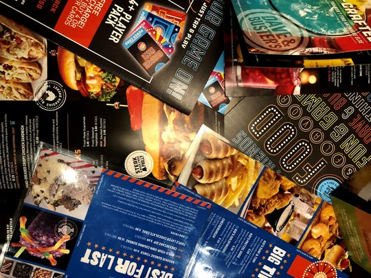 A sea of menus from Dave & Buster's in south Fort Myers.