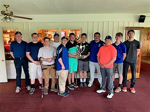 The Oconto High School golf team poses with the Challenge Cup after defeating Oconto Falls in their annual match.