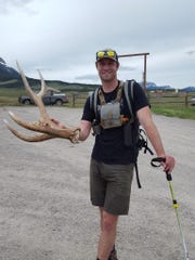 Colby Adamek of Bozeman shows off the elk antler he found hiking on the Sun River WMA.
