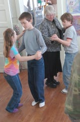 Bynum teacher Susan Luinstra takes Layne Durfee for a waltz partner, dancing along with, at left, Eli McFadyen and Devann Saylor in 2007.