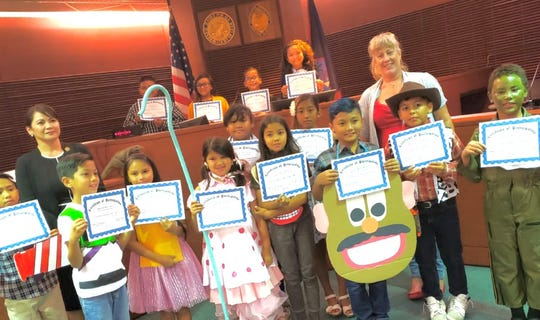 The fourth and third grade G.A.T.E. students of Capt. H.B. Price School participated in the Judiciary of Guam's Law Week activities by performing the Mock Trial The People vs Woody on May 1. Front row from left: Drady Cruz, juror; Skyler Francisco, Buzz Lightyear; Isabel Reyes, jury foreperson; Vayla Gumabon, Little Bo Peep, Nova Pagan, Mrs. Potato head; Slade DeGracia, Mr. Potato head; Preston Pangelinan, Sheriff Woody; and Ioane Camacho, Sergeant Soldier. Second row from left: Judge Maria Teresa Bonifacio Cenzon,  judge of the Superior Court of Guam  Supreme Court of Guam, Samara Bongato, juror; MollySky Dahilig, juror; and Vickie Loughran, G.A.T.E. teacher.   Back row standing on podium from left: Felix Ulloa (partially hidden), clerk of court and bailiff; Sophia Nangauta, defense attorney; Cyan Sablan, judge; and Abigail Lopez, prosecuting attorney.