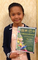 On May 10 Capt. H.B. Price School's math team members Abigail Lopez and Taga Blas were presented with individual place trophies from the March 30 GATE-sponsored island-wide Math Olympiad that was held at the Sheraton Laguna Guam Resort.