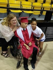 Jacoby's mother, Dixie Bergeron, left, Jacoby Bergeron and Jacoby's sister Myracle at his Petal High School graduation Thursday, May 16, 2019.
