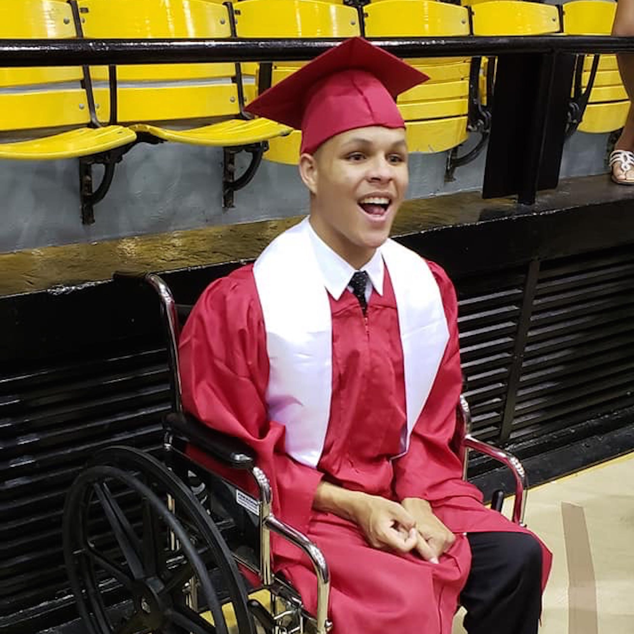 Better than a diploma: Teen, usually in a wheelchair, walks the stage to cheers, tears