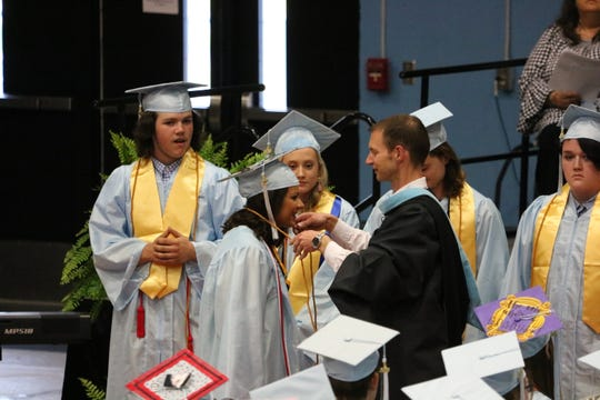 Hayleigh Ricketts receives her honors cord at graduation from Principal Evan Jackson.