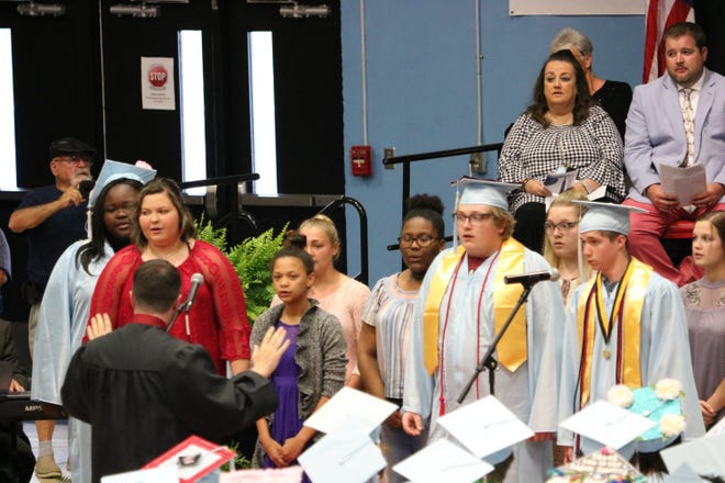 The UCHS Choir performs for the graduation ceremony.