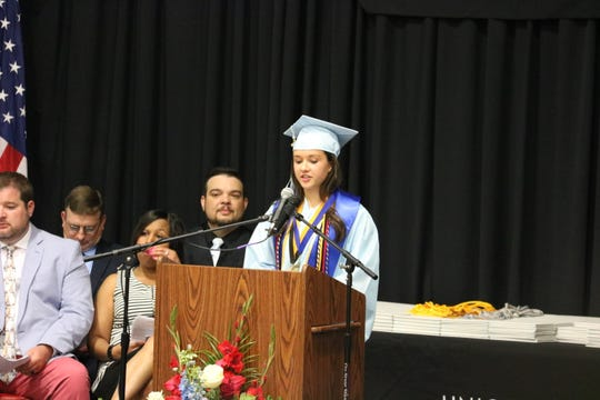Dual Enrollment Salutatorian Emma Sprague gives her speech.