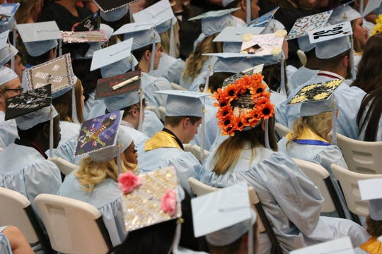 Seniors came with decorated caps to graduation.