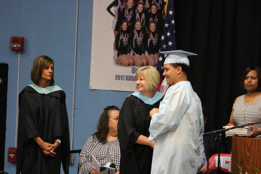 Braedon Davis receives his diploma from Superintendent Patricia Sheffer at the 2019 graduation commencement.