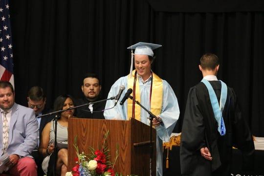 Micah Coy gives the invocation at graduation 2019.