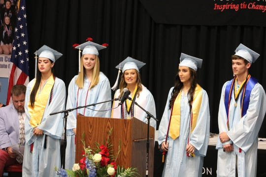 The senior class officers lead the Pledge of Allegiance at graduation. Officers include President Railey Carter, Vice President Taylor Mayberry, Secretary Maddie Hancock, Treasurer Alexes Huff, and Chief of Staff Jordan Stewart.