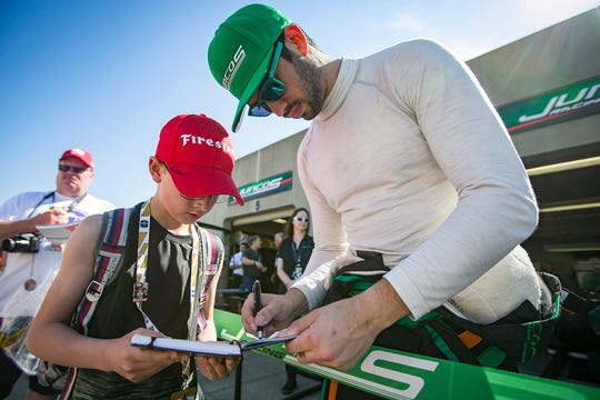 Kyle Kaiser, 23, signs an autograph for a young fan, May 18, 2019, at the Indianapolis Motor Speedway, the morning of qualifying day. Kaiser ended up bumping Fernando Alonso, McLaren from the Indy 500 field, Sunday May 19, 2019.