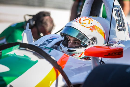 Kyle Kaiser looks out of his car during morning practice Saturday, May 18, 2019, before qualifiers for the Indy 500, at Indianapolis Motor Speedway.