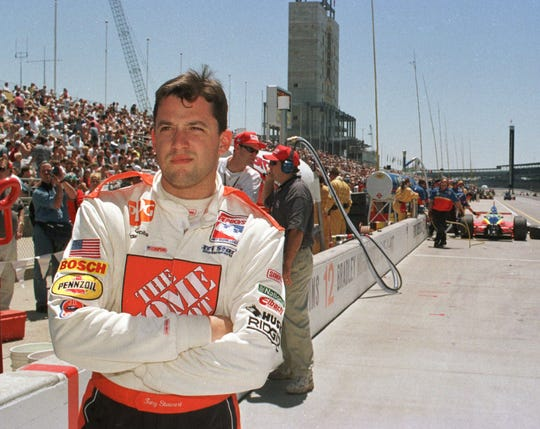 Tony Stewart waited for his car in the pit area of  Indianapolis Motor Speedway on May 27 1999 during the final practice session befor the 83rd Indy 500 the next day. Stewart ran both the IRL Indy 500 and the NASCAR race in Charlotte on the same day. (AP Photo/Tom Strickland)