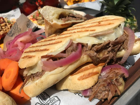 The red-wine-braised short rib and provolone grilled cheese sandwich with pickled red onions is served for the 2019 Indy 500 at Indianapolis Motor Speedway's private Hulman Terrace Club.