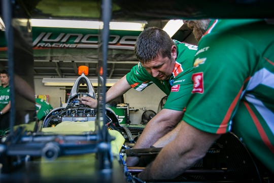 Anthony Knighten, center, fueler for the Juncos Racing makes repairs to a race car, Saturday, May 18, 2019, at Indianapolis Motor Speedway. The team built overnight after Kyle Kaiser crashed on Friday during practice the day before qualifying day.