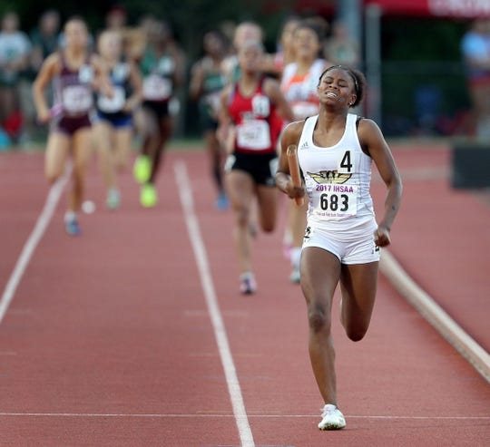 Warren Central's Mikeisha Covington finishes the final legs of the girls 4x100 relay securing the team win for the Warriors at the 2017 state meet.
