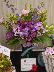 """The first place amateur division flower display at the 13th Annual Festival of Flowers in 2018; Susan Nehring, for """"Spring Debate."""""""
