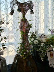 """The first place professional division flower display at the 13th Annual Festival of Flowers in 2018; Justine Zimmer, of Tornado TeaPartyZ, for """"Jasmine."""""""