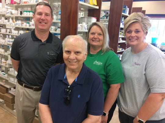Bob Boyd, front, is flanked by Vaughn pharmacists (from left) David Kearney, Jane Ellison and Hilary Flickinger.