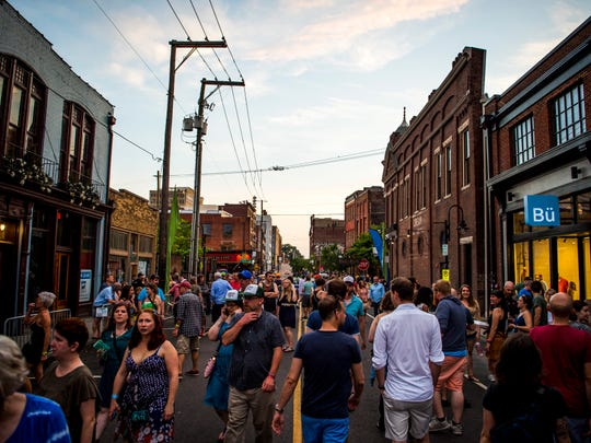 Festival goers walk down Jackson Ave during the Rhythm N' Blooms Festival held in Knoxville's Old City on Saturday, May 18, 2019.