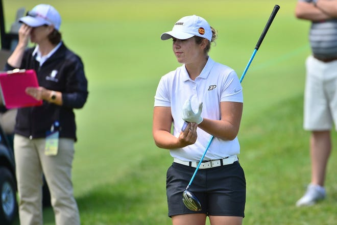 Purdue women's golfer Danielle du Toit adjusts her glove.