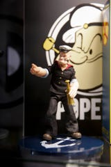 A Popeye figurine sits on a shelf at Infinity Toys, 828 Main st., Monday, May 20, 2019, in Lafayette.