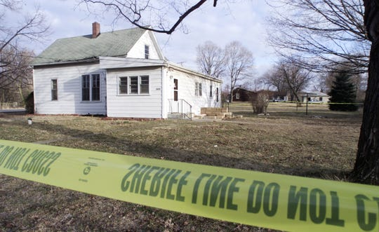 Police tape hangs on March 5, 2001, at the residence at 2625 Poland Hill Road, where Tony Heathcote was stabbed 39 times on March 4, 2001, in Lafayette. Jurors convicted Anastazia M. Schmid of murder in October 2002, but a U.S. District Court vacated that conviction last week.
