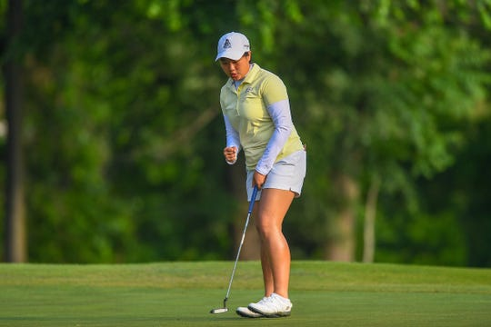 Purdue women's golfer Inez Wanamarta reacts to a putt.