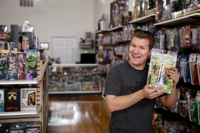 William Higbie, owner of Infinity Toys, 828 Main st., poses for a photo holding a Teenage Mutant Ninja Turtles figurine Monday, May 20, 2019, in Lafayette.