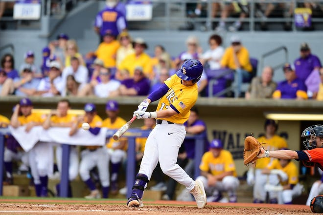LSU baseball player Chris Reid swings at a pitch.
