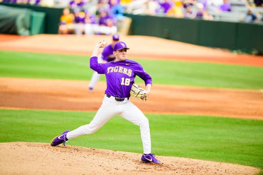 LSU baseball player Cole Henry delivers a pitch.
