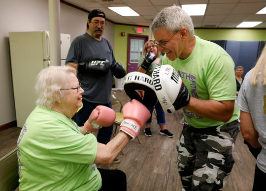 Bonnie Clark, left, hits Jamey Mathias's punch mitts Monday, May 20, 2019, during a Rock Steady Boxing class at Olivedale Senior Citizens Center in Lancaster. Mathias teaches the boxing course for Olivedale members every Monday and Wednesday. Originally designed for people with Parkinson's disease, Mathias says the class can help with anyone's balance issues or cardiovascular health.
