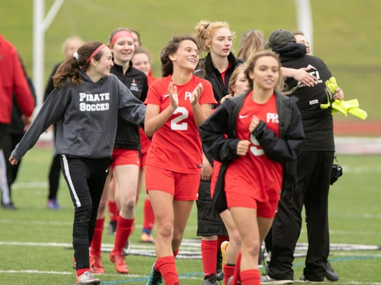 Solana Kelly (2), who scored the winning goal with 3:50 remaining, celebrates with her teammates after a 2-1 victory over Dexter on Monday, May 20, 2019.