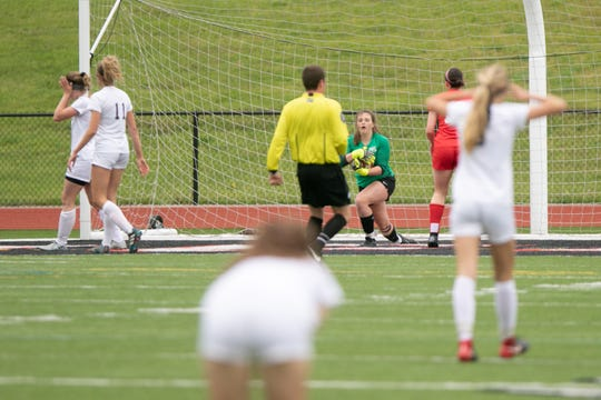 Pinckney goalkeeper Brianna Stevens clutches the ball after making a save in the final seconds to preserve a 2-1 victory over Dexter on Monday, May 20, 2019.