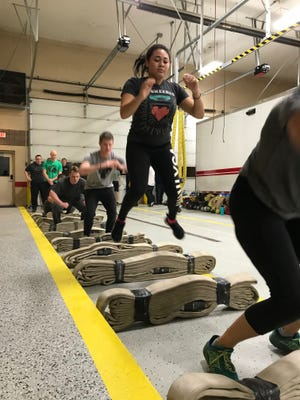 Judaya Vasquez works out with other cadets in the Brighton Area Fire Authority Fire Academy.