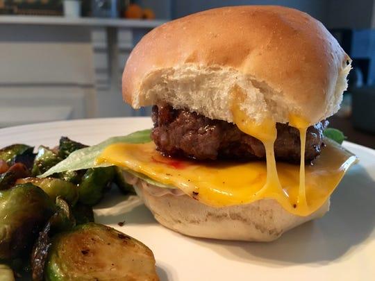 A homemade burger using fresh meat from Red Hog Restaurant & Butcher Shop.
