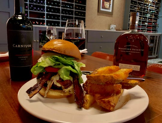 The Cheese Curd burger, made with melted cheese curds, lettuce, tomatoes, onions, pickles from Steak & Bourbon.