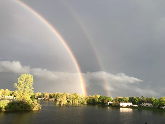 Dan Mark, of Haslett, took this photo Sunday of a double rainbow that he spotted from his apartment balcony. It overlooks Lake of the Hills, west of Lake Lansing.