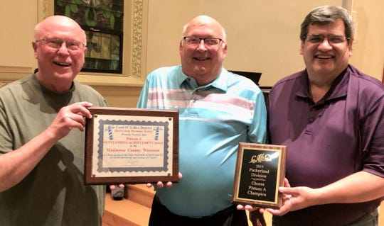 Clipper City Chordsmen, from left: district delegate Bob Fricke, chapter President David Rabe and Director Dave Buss with championship plaque and District Outstanding Achievement Award.