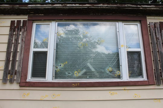 Bullet holes outside of the home of where Dorothy Jackson, 67, was shot and killed May 18.