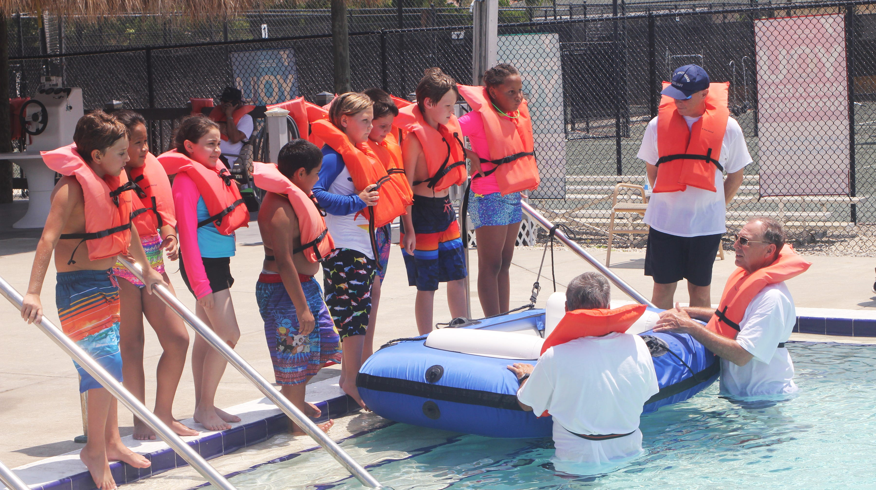 Members of the Marco Island Coast Guard Auxiliary Flotilla 9-5 teach basic boat safety to one of the revolving groups.