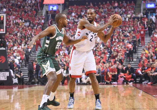 The Bucks' Khris Middleton has drawn a tough assignment in defending the Raptors' Kawhi Leonard during the Eastern Conference finals.