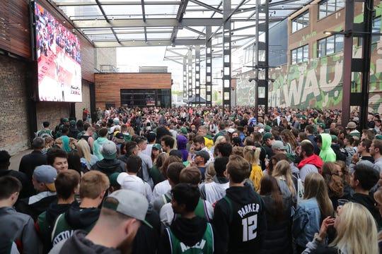 Bucks fans fill the beer garden Sunday.