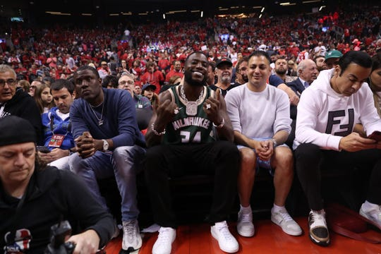 Rapper Gucci Mane (center) sat courtside during Game 3 of the Eastern Conference Finals on May 19, proudly adorning a Giannis Antetokounmpo jersey.